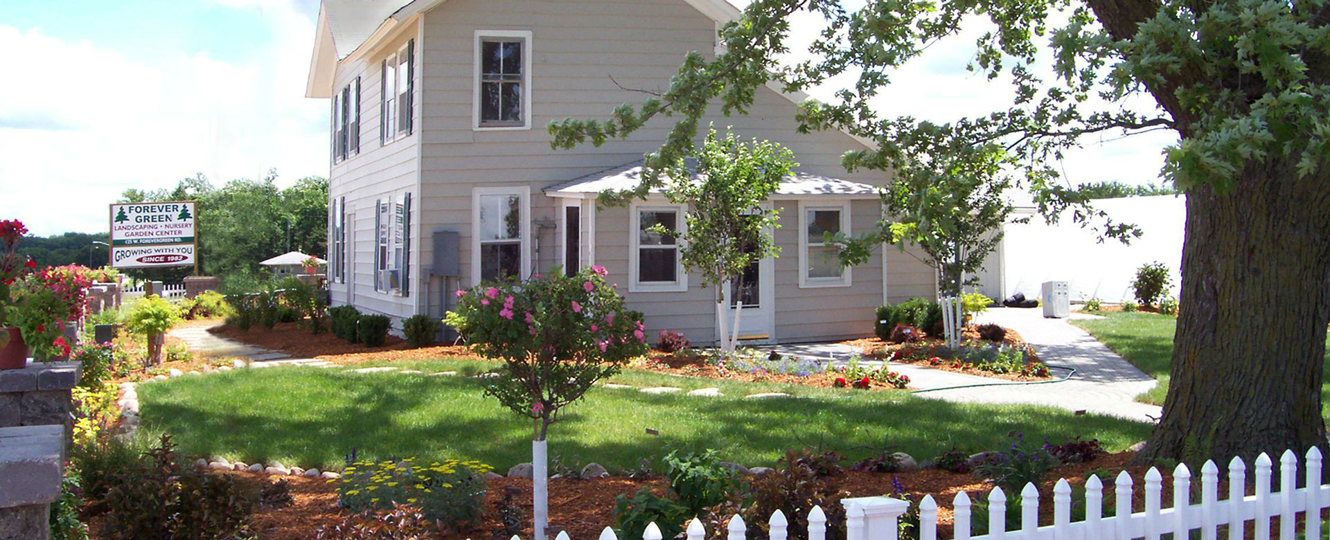Forever Green Coralville Iowa Who We Are header landscaping house
