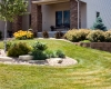 Forever Green Coralville Iowa Landscaping planting beds outcropping limestone