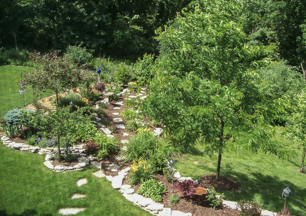 Forever Green Coralville Iowa Landscaping plantings beds pathway edging
