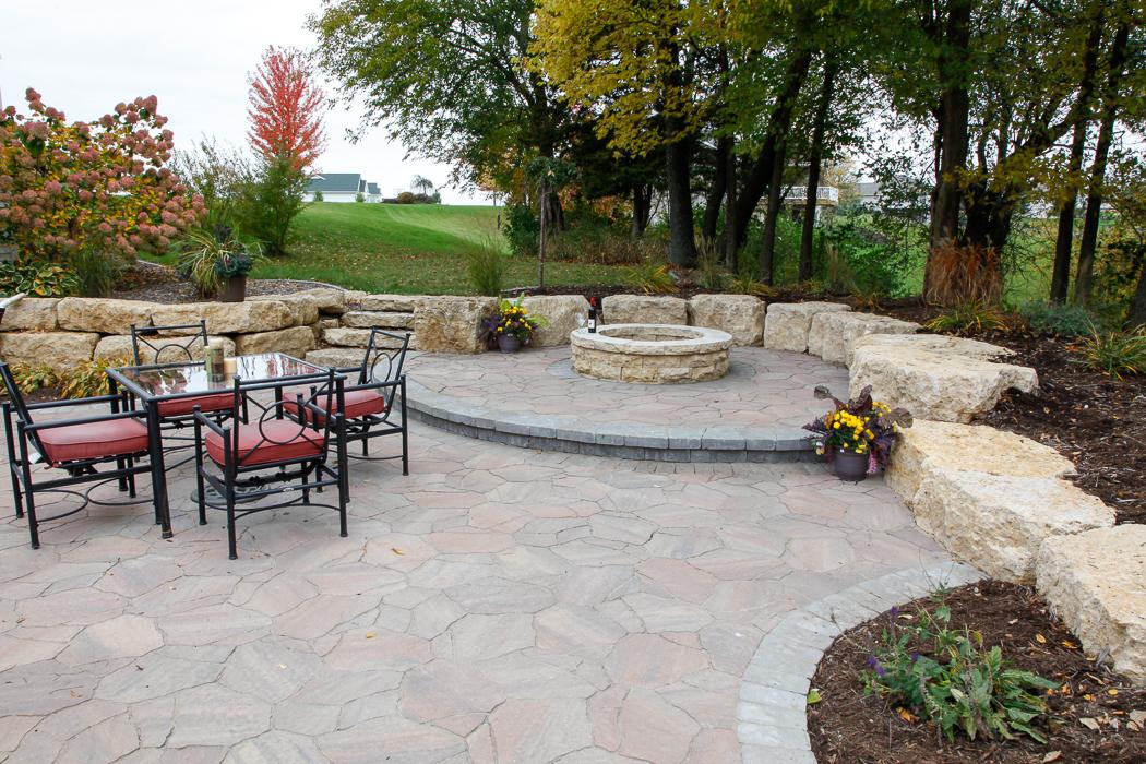 Forever Green Coralville Iowa Patios fire pit limestone