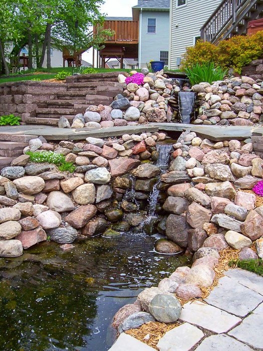Forever Green Coralville Iowa Water Features waterfall natural pond house