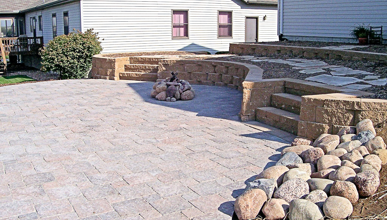Forever Green Grows Coralville Iowa Fire Pits boulder wall retaining wall patio pathway