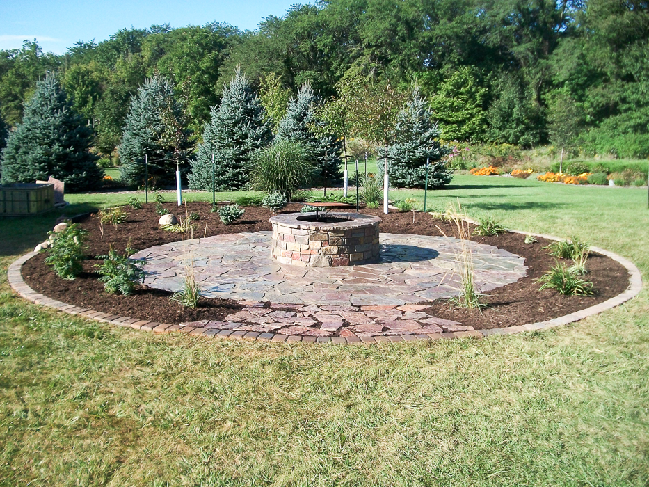 Forever Green Grows Coralville Iowa Fire Pits stone backyard plants
