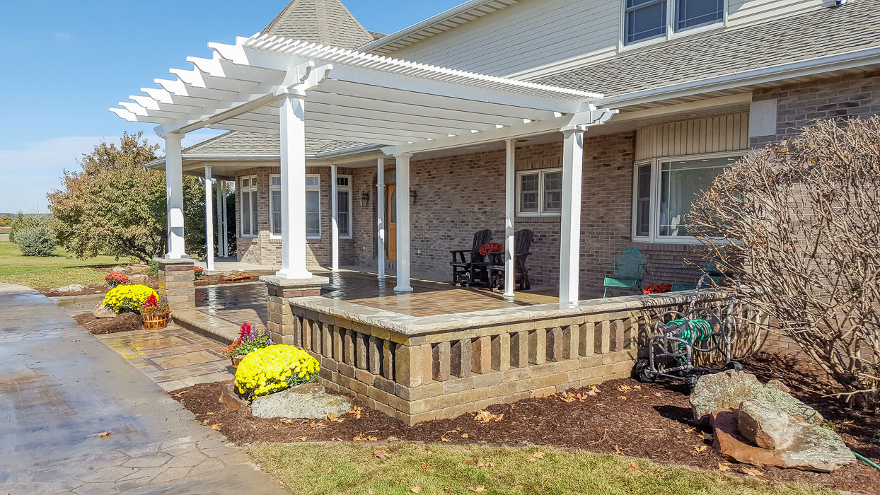 Forever Green Coralville Iowa Pergola brick wall house plantings