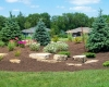 Forever Green Coralville Iowa Landscaping berm plantings outcropping limestone