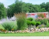 Forever Green Coralville Iowa Landscaping boulder edging plantings berm