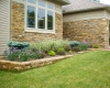 Forever Green Coralville Iowa Landscaping front planting beds small wall