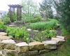 Forever Green Coralville Iowa Landscaping planting beds perennial garden pathway limestone wall