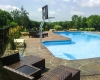 Forever Green Coralville Iowa Landscaping plantings around pool natural screen