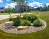 Forever Green Coralville Iowa Landscaping plantings outcropping round beds