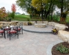 Forever Green Coralville Iowa Patios fire pit limestone