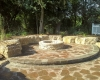 Forever Green Coralville Iowa Patios limestone fire pit seating wall